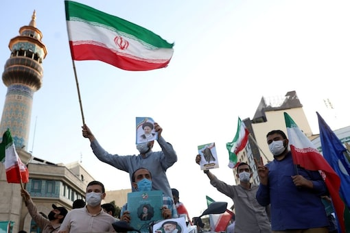 Supporters of presidential candidate Ebrahim Raisi hold posters of him during an election rally in Tehran, Iran. Reuters
