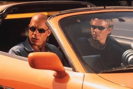 Still from 2 Fast 2 Furious Featuring Paul Walker, Vin Diesel and the Toyota Supra.