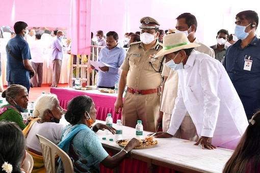 Telangana CM K Chandrasekhar Rao lunches with people in adopted village. (Image: IANS)