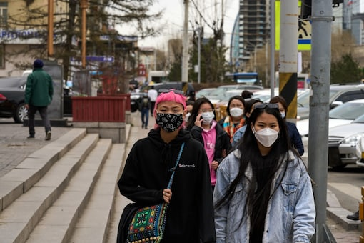 Pedestrians wear face masks in Ulaanbaatar, Mongolia, on May 12, 2021. Mongolia now ranks among the top countries that have fully vaccinated its population. (Khasar Sandag/The New York Times)