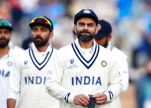 India's captain Virat Kohli, right, reacts after their loss on the sixth day of the World Test Championship final cricket match between New Zealand and India, at the Rose Bowl in Southampton, England, Wednesday, June 23, 2021. (AP Photo/Ian Walton)