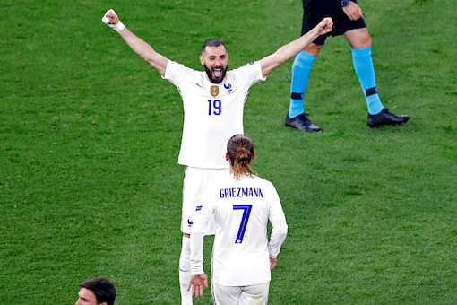 Karim Benzema  celebrates with Antoine Griezmann (AP)