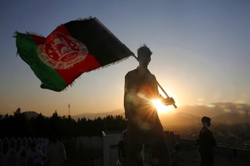 A man holding the national flag of Afghanistan, used for representational purpose. (AP Photo)