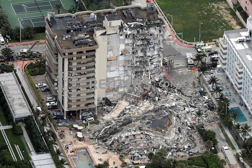 An aerial view showing a partially collapsed building in Surfside near Miami Beach in Florida in US on June 24. (Image: Reuters)