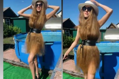 Video grab of woman wearing her hair as dress. (Credit: Instagram)