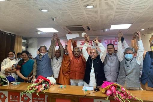 Union Minister Narendra SIngh Tomar, Ex-Uttarakhand CM Trivendra Rawat, Tirath SIngh Rawat and CM-Elect Pushkar SIngh Dhami at the BJP Legislature Meet.