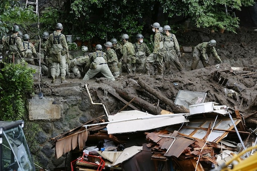 Members of Japanese Self-Defence Forces conduct rescue and search operartion at a mudslide site caused by heavy rain at Izusan district in Atami, west of Tokyo, Japan. (Reuters)