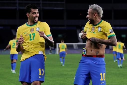 Brazil's Lucas Paqueta celebrates with Neymar (AP)