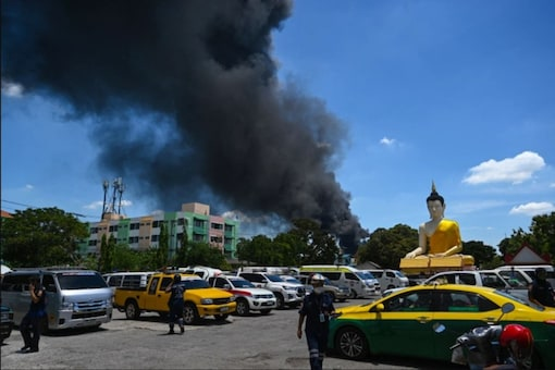 Chemicals at a factory just outside the Thai capital burst back into flames briefly on Tuesday.
