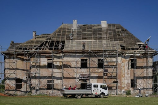 People repairing Centuries-Old-Monuments, to protect the history. (AP)