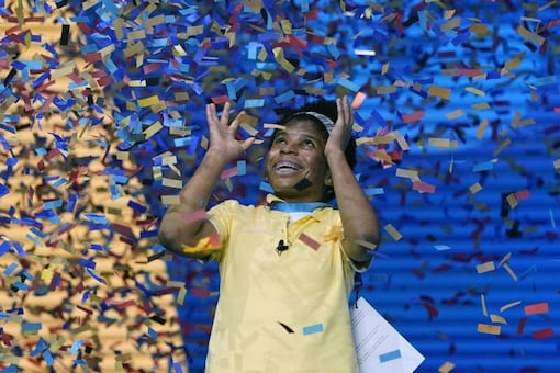 Zaila Avant-garde, 14, from Harvey, Louisiana is covered with confetti as she celebrates winning the finals of the 2021 Scripps National Spelling Bee at Disney World. (Credit: AP)