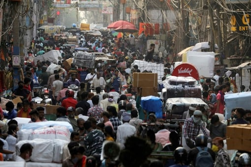 FILE PHOTO: People walk at a crowded market in the old quarters of Delhi, India, April 6, 2021. REUTERS/Anushree Fadnavis/File Photo
