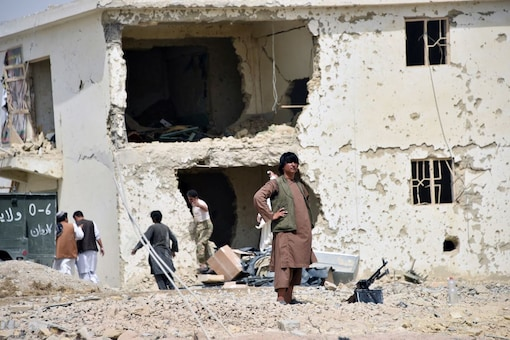 Afghan men inspect the site of a car bomb attack in Kandahar province, Afghanistan July 6, 2021. (REUTERS)