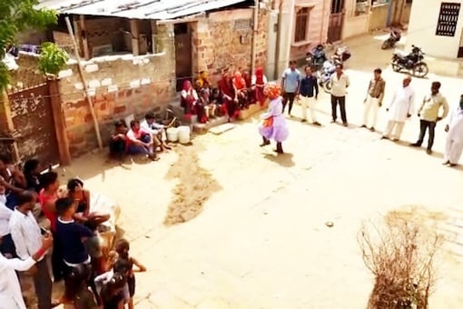 Celebrating water: villagers dance and sing on getting water connections.