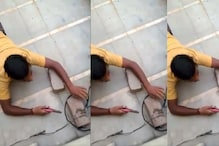 WATCH: UP Man Illegally Stealing Electricity Crawls on Floor to Cut Power Lines
