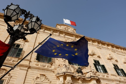 Flags of Malta and European Union fly outside the Auberge de Castille, the Office of Malta's PM Robert Abela. (Reuters/File)
