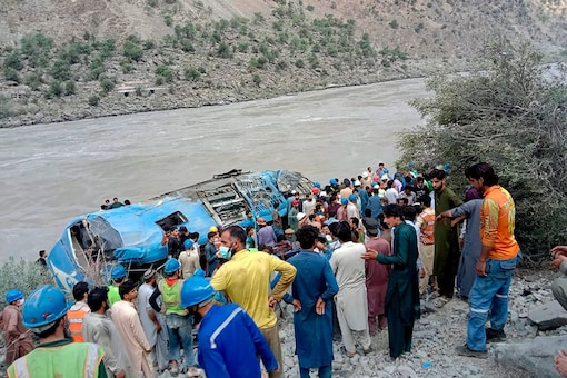 People gather at the site of the bus tragedy, in Kohistan district of Pakistan's Khyber Pakhtunkhwa province. (File pic: AP/PTI)