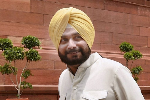 As Congress high command sees Sidhu as 'future', Amarinder Singh's objections to his elevation as PPCC chief has a reference point in the party's history. (File photo)