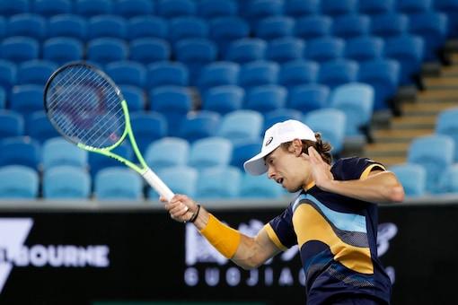 Australia's Alex de Minaur hits a return (Reuters)