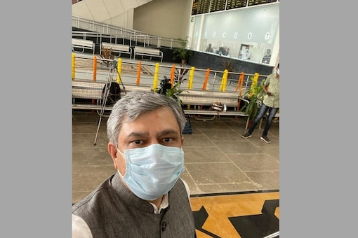The railway minister clicked the image near the ticket counter, where a few staffers sat behind the glass separation waiting for travellers. (Image: Twitter)
