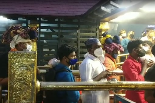 Devotees arrive at Kerala's Sabarimala temple on Saturday for darshan as the shrine reopened post second wave of Covid-19.