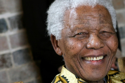 Late South African president Nelson Mandela smiles as he poses for a portrait during an event in London on May 24, 2006. Image courtesy: Shutterstock.