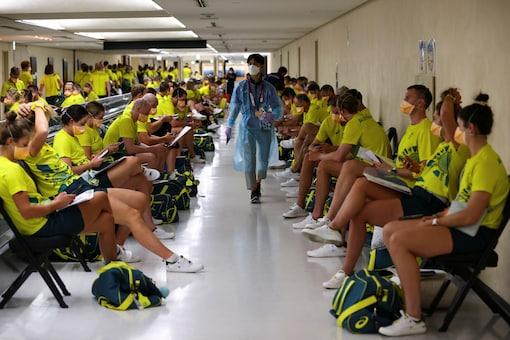Australian team wait to take the quantitative coronavirus antigen test after arriving at Narita International Airport in Tokyo (Reuters)