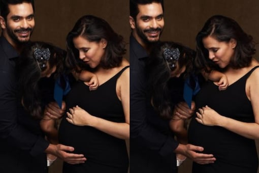 Actress Neha Dhupia took to Instagram on Monday morning to share a good news with friends and followers. The actress announced her pregnancy with a picture featuring husband, actor Angad Bedi and daughter Mehr.