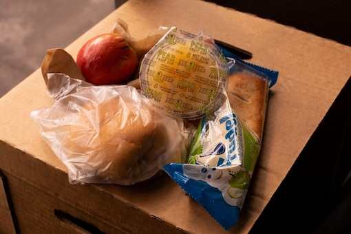 School officials, lawmakers, anti-hunger organizations and parents are applauding it as a pioneering way to prevent the stigma of accepting free lunches and feed more hungry children.