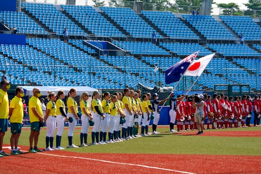 Japan and Australia line up ahead of their softball game at the 2020 Summer Olympics (AP)