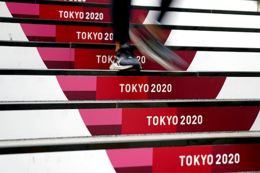 A commuter walks down stairs leading to a subway station before Tokyo 2020 (AP)