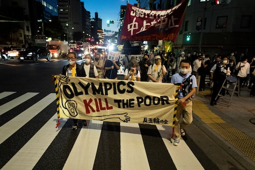Protesters march to protest against holding the Tokyo 2020 Olympic Games  (AP)