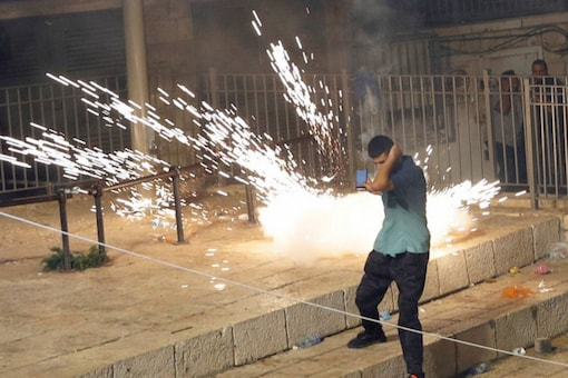 Palestinian youth threw stones, lit fires and tore down police barricades in the streets leading to the walled Old City gates. (AP/ File photo)