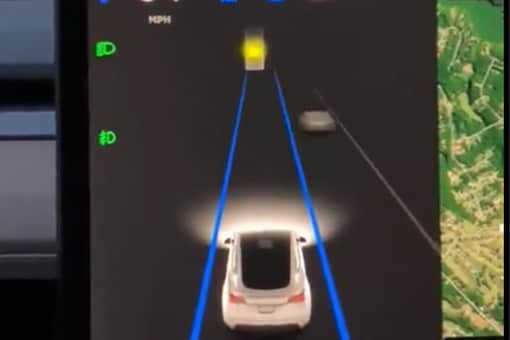 The autopilot system of a Tesla car can be seen confusing the yellow moon in the sky. (Credits: Twitter/ Jordan Nelson)
