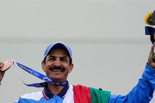 Bronze medalist Abdullah Alrashidi, of Kuwait, celebrates after the men's skeet at the Asaka Shooting Range in the 2020 Summer Olympics, Monday, July 26, 2021.