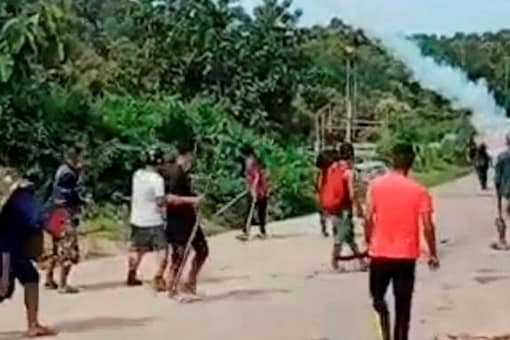 Locals during a clash with police personnel at Assam-Mizoram border at Lailapur in Cachar district, Monday, July 26, 2021. (PTI Photo)