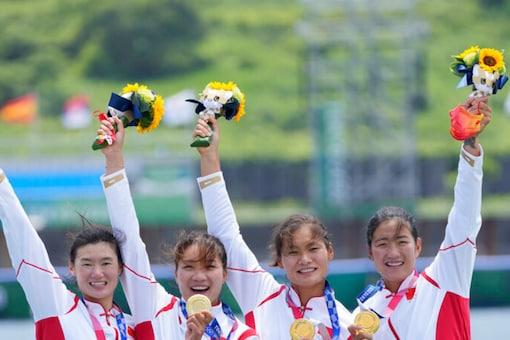 Chen Yunxia, Zhang Ling, Lyu Yang and Cui Xiaotong of China won women's quadruple sculls gold (AP)