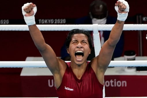Lovlina Borgohain of India reacts hearing the judges decision in her victory over Nien-Chin Chen, of Chinese Taipei, in their women's welter weight 69kg quarterfinal boxing match at the 2020 Summer Olympics, Friday, in Tokyo, Japan. (Photo: AP)