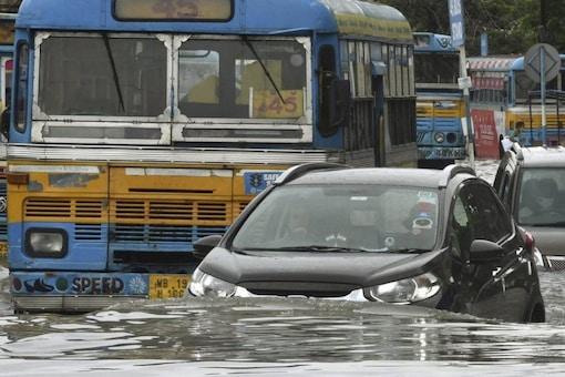 Kolkata: Vehicles wade through a waterlogged road during rain in Kolkata, Friday, July 30, 2021. (PTI Photo)(