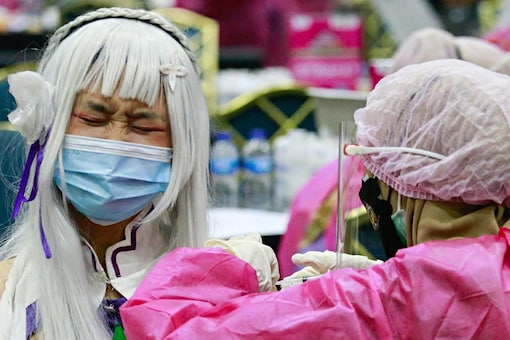 A cosplayer wearing a protective face mask reacts as she receives a dose of a vaccine against COVID-19 in Jakarta, Indonesia, July 31, 2021. (Reuters)