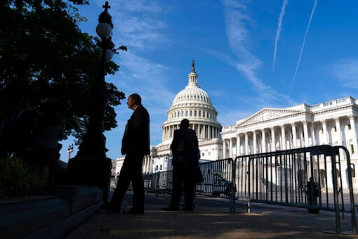 Biden Signs Bill To Fund Capitol Security, Afghan Visas