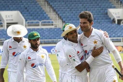 Pakistan cricketers celebrate their win over West Indies in the second Test.