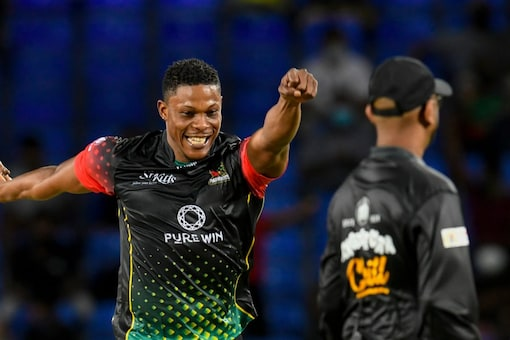 Sheldon Cottrell celebrates the fall of another Barbados Royals' wicket.