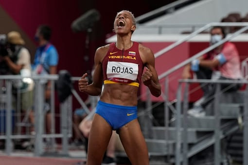 Rojas already had the gold medal assured when she took the last of her six attempts, finishing with a mark of 15.67 meters to break a record set in 1995.