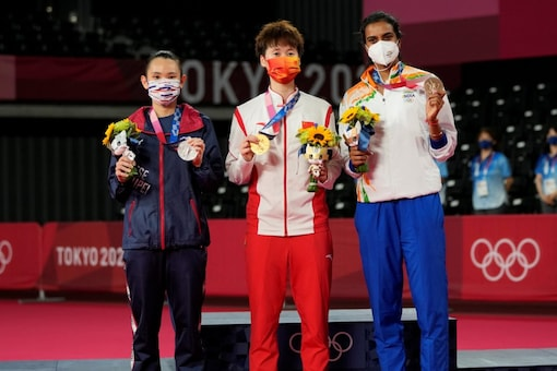Silver medallist Taiwan's Tai Tzu-Ying, Gold medalist Chen Yu Fei and Bronze medalist PV Sindhu pose with their medals (AP)