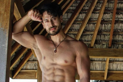 Actor Tiger Shroff shows off his chiselled physique in red shorts.