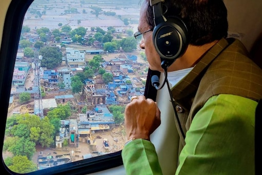 Datia: Madhya Pradesh Chief Minister Shivraj Singh Chouhan conducts aerial survey of flood-affected areas of the state, in Datia district, Wednesday, Aug. 4, 2021. (PTI Photo)