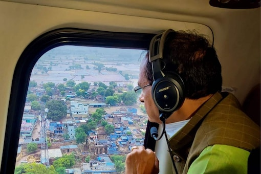Datia: Madhya Pradesh Chief Minister Shivraj Singh Chouhan conducts aerial survey of flood-affected areas of the state, in Datia district. (PTI Photo)