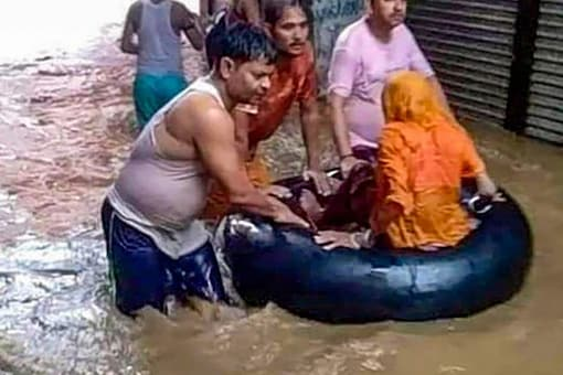 The IMD said rainfall is likely to decrease over north Indian plains and increase over the hills. (PTI photo of floods in Bhopal)