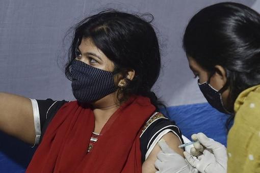 A beneficiary receives a dose of Covid-19 vaccine, at a health centre in Kolkata, Saturday. (PTI)